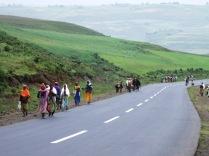 Men and women walking alngside road to Blue Nile