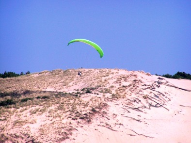A paraglider on the Pilat dune in the Bay of Arcachon -southwest France
