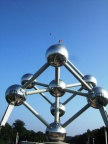 The atomium in Brussels, Belgium. Note the jumper on a zip line up top!
