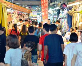 Young Taiwanese stroll down the narrow alleys of the night market